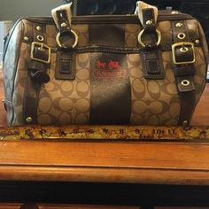 Large Coach bag Large Coach bag, with some normal wear and tear on the handles but still in great condition!! 14' wide 8' high with lots of pockets and zipper compartments and brown interior. Coach Bags