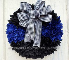 This wreath takes 6 hours to make but is sure worth the time. This wreath replicates the Thin Blue Line in honor of our law enforcement. It is