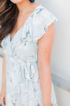 Blue floral wrap dress on Maxie Elle #freepeople #wrapdress #floraldress #summer #style