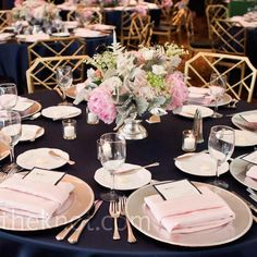Dark blue table cloth, silver / grey show plate, white serving plates, silver cutleries. Change blush napkins to clear grey and different centrepiece (no pink)