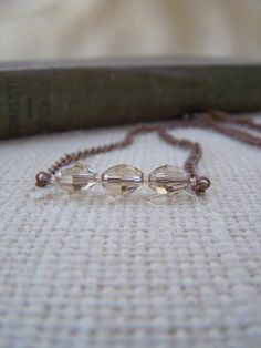 Faceted Glass Beaded Chain Necklace in Shades of Antiqued Copper and Champagne - Minimalist Necklace - Handmade Jewelry  - Ready to Ship. $8.50, via Etsy.