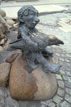 Wind dwarf Sudri - statue by Jochen Muller; the wind dwarves mark the four compass directions at the base of The Fountain of Wisdom; at Mythenweg in Thale, Germany
