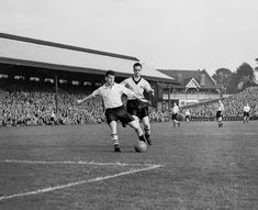 1955. Johnny Haynes gets in a shot with Hull City's Tom Berry about to make the tackle