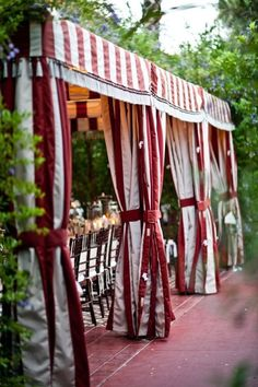 party tent in a red stripe that manages to look elegant rather than elephant