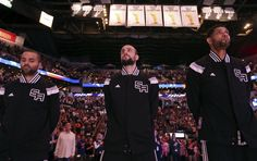 San Antonio Spurs' Tony Parker (from left), Manu Ginobili, and Tim Duncan stand during the national anthem before the game with the Golden State Warriors Sunday April 5, 2015 at the AT&T Center. Photo: San Antonio Express-News