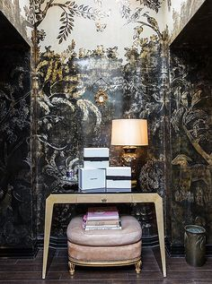 a shimmering mural by decorative painter and interior designer John Opella serves as a lavish and lyrical backdrop. The furniture mixes French and chinoiserie elements