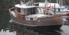 "Steel trawler ""Pisces"" Check out article on Passagemaker site Love these workboat lines!"