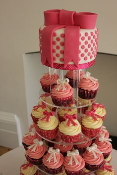 Bows, Bows, Bows: Pink and White Polka Dot Wedding Cake with a Pink Fondant Bow and matching cupcakes with Pink and White Fondant Mini-bows www.restorationcake.co.uk