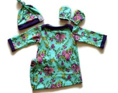 Aqua Green Floral Baby Gown, Top Knot Hat, and No Scratch Mittens. Baby gown in sizes 0-3 Months and 3-6 Months. Shop top knot hat, no scratch mittens, bow headband, and pacifier holders