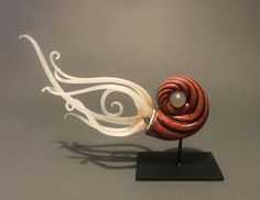 A beautiful sculpture captured in motion. Makes a fabulous display and conversation starter. Harvest by Jennifer Caldwell. Art Glass Sculpture available at www.artfulhome.com