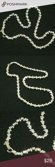 Rhinestone Necklace Rhinestone Necklace. Length: 15 inches. Used item: any wear shown in pictures.  Silver tone. Lightweight and comfotable. Great condition.   Bundle Up!  Offers always welcome :) Jewelry Necklaces