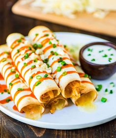 Slow Cooker Buffalo Chicken Taquitos. Easy, CHEESY, and ADDICTIVE! Healthy crockpot recipe that's perfect football food for game day and tailgates. @wellplated