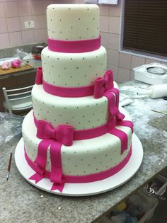 Pink and black for this beatiful four tiers debutante cake #cakedesign #birthdaycake