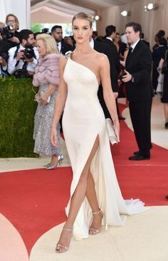 Rose Huntington-Whiteley at 2016 Met Gala in white one shoulder Grecian Goddess gown