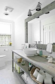 Rustic Bathroom with simple vanity and vessel sink and beautiful mirror