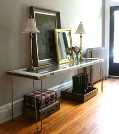 Our entry table made from an antique salvage door and hairpin legs!
