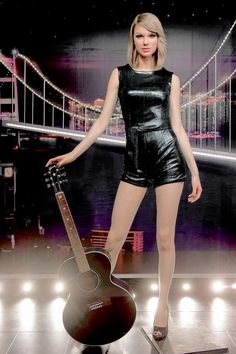Taylor with her red guitar in a leather romper!