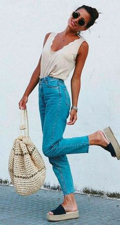 what to wear with a pair of jeans : bag + platform sandals + top