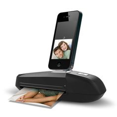 iPhone Photo Scanner.  I don't have the iPhone 4, but this seems kind of interesting.