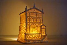 A vintage luminary lights up the dark winter night.