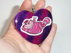 Cheshire cat striped glitter pendant available at my shop, Rainbow Dark Creations