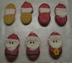 """""""Nutter Butter Mini Santas"""" -- Whole-body Santas, rather than the more typical just faces. Requires a bit more decorating talent, but instructions at click-through."""