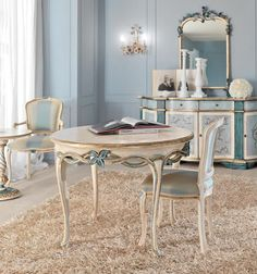 Paris collection dining table shown here finished in an antique ivory, gold leaf and blue. Made to a high standard being carved from solid walnut wood and painted by artisans to create that original Parisian look.