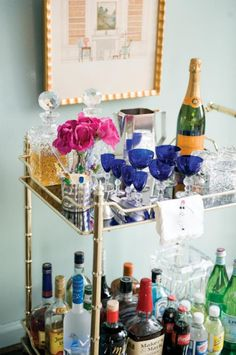 All my favorites: wall color, bar cart, color palette, Veuve.