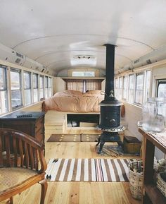 A little more inspiration for our vintage caravan reno - because every bus or caravan needs a little wood heater to keep warm, right. This is going on. Bus Remodel, School Bus House, Converted School Bus, Bus Living, Tiny Living, Living Room, School Bus Conversion, Van Home, Bus Life