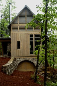 Architecture and Interiors by Krumdieck A+I  www.krumdieck.com  Metal Roof Metal chimney Board and Batton Mountain Retreat Cabin Stone Arch Steep Site Louvre Wood Siding