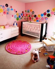 Dotty Modern Nursery Idea: Our nursery idea was to create a space for Saxon that didn't completely spell B-A-B-Y, a room that she wouldn't outgrow right away.   Wow. What a difficult