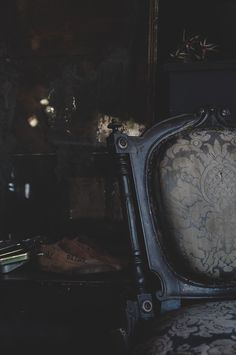 I love this shot in the corner of the store with the beautiful aesthetic movement chair with original upholstery and the dark shimmering mirrors in the background. #interiors #interiordesign # decor #gothichome #gothic #darkinteriors #darknostalgia #victorian #victoriana #greywalls