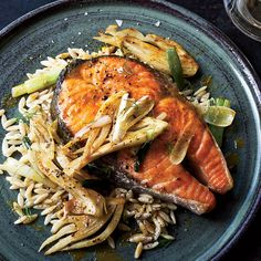 Salmon Steaks with Curried Fennel-Wine Sauce | A copper pan works especially well here because the fennel is cooked until silky over long, low heat. F&W's Marcia Kiesel serves it in a curry-laced wine sauce over salmon.