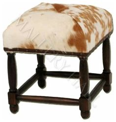 """Custom-made foot stool covered in longhorn hide with wood frame. Specifications: Width: 13"""", Depth: 13"""", Ht: 15"""""""
