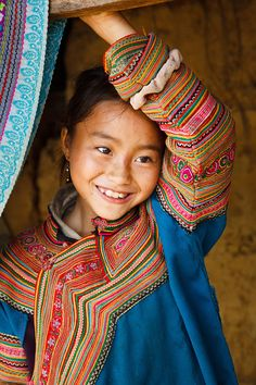 Travel Photography Portfolio - www.coolephotography.co.uk Coc Ly, Lao Cai, Vietnam May 2010 Portrait of a Flower H'mong hill tribe girl wearing traditionally colourful clothing, in a small village between Coc Ly and Cao Son