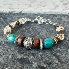 Womens Sterling Bali Genuine Turquoise Shell by BeadModern Coconut Shell, Adjustable Bracelet, Sea Shells, Gemstone Jewelry, Turquoise Bracelet, Bali, Handmade Jewelry, Gemstones, Sterling Silver