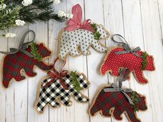 """Rustic Burlap Bear Christmas Ornaments - - """"Give your Christmas tree a dash of farmhouse style with rustic plaids, greenery and the cozy texture of burlap. While the appliqued bears are a fun, unexpected holiday motif, it's easy to adapt to any theme. Burlap Christmas Ornaments, Fabric Christmas Trees, Fabric Ornaments, Fabric Christmas Decorations, Diy Ornaments, Woodland Christmas, Handmade Christmas, Christmas Diy, Christmas 2019"""
