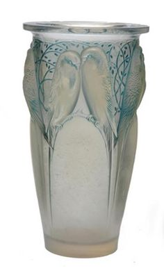Description:	A Rene Lalique Ceylan Pattern Opalescent Glass Vase Model introduced 1924 Cylindrical, moulded with a continuous pattern of budgerigars perched amongst branches, with a soft blue staining, wheel-cut signature R. Lalique France and inscribed N. 905, 24 cm high.