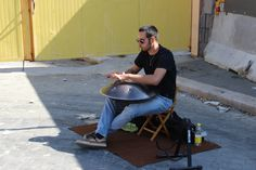 A drummer plays the #hangdrum in #Testaccio