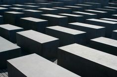 Each stone at the Berlin Holocaust Memorial is a unique shape and size. The Memorial was designed by architect Peter Eisenman.