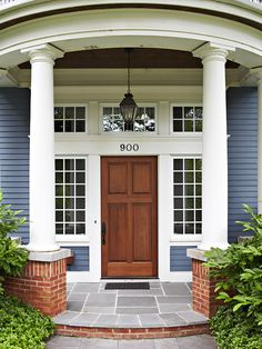 Pretty windows and white trim makes this classic brown door stand out. See more ideas for exteriors: http://www.bhg.com/home-improvement/exteriors/?socsrc=bhgpin072612classicbrowndoor