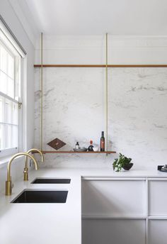 Wood trim at top of backsplash, suspended shelf Which is our favourite idea here? Is it the elegant framed drawer detail, the suspended shelf for everyday condiments, or the unexpected dark-toned sinks and twin gold mixers? Take your pick Clever Design, Küchen Design, Layout Design, Design Ideas, Kitchen Lighting Design, Interior Design Kitchen, Beautiful Kitchen Designs, Beautiful Kitchens, Cuisines Design