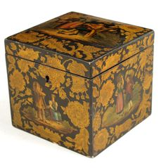 A Regency penwork cube tea caddy, each side painted with panels of figures in various pursuits within penwork foliate borders, with a lidded interior, 4¼in (10.6cm) high, 4in (10.4cm) square.
