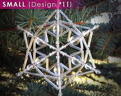 Browse unique items from LaneigeDesign on Etsy, a global marketplace of handmade, vintage and creative goods. Beaded Christmas Ornaments, Snowflake Ornaments, Snowflakes, Christmas Crafts, Beaded Snowflake, Christmas Decorations, Bead Weaving, Bead Crafts, Etsy Seller