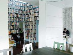 floor to ceiling books. nook in the next room. chandelier.