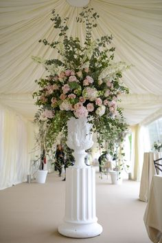 The form of this arrangement leaves little to no excess space. It's seems to be a fan shaped arrangement using a variety greenery and flowers like roses. Church Flower Arrangements, Church Flowers, Wedding Arrangements, Floral Arrangements, Table Arrangements, Wedding Ceremony Flowers, Floral Wedding, Wedding Bouquets, Trendy Wedding
