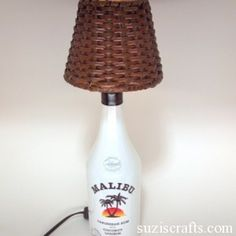 How to Make a Liquor Bottle Lamp Suzis Crafts Liquor Bottle Crafts, Liquor Bottles, Bottles And Jars, Empty Bottles, Candle Shades, Jar Art, Light Crafts, Wine Glass Charms, Bottle Art