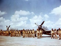 Formation of pilots of the 201st Mexican Fighter Squadron in front of P-47's. 201st Mexican Fighter Sqd., Mexican Exp. Air Force. Luzon PI - July 1945