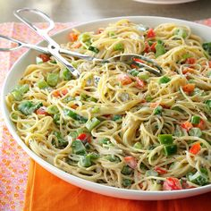 Vermicelli Pasta Salad Recipe -I started making this salad because it's loaded with peppers, my husband's favorite. Don't be surprised when there are no leftovers to take home after the family reunion, picnic or church potluck. —Janie Colle, Hutchinson, Kansas