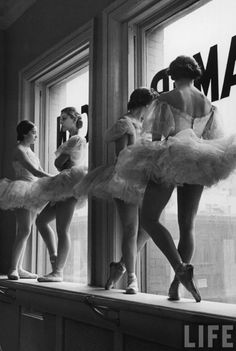 "The Ballerinas by Alfred Eisenstaedt.  The photographer is best known for his candid photography on V-J day and the famous photo:  ""In New York's Times Square a white-clad girl clutches her purse and skirt as an uninhibited sailor plants his lips squarely on hers."""